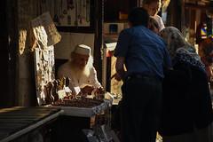 Negotiations on the bazaar (Tomislav Bicanic) Tags: street old travel bridge light mostar bazzar merchant customers oldbridge bosniaandherzegovina negotiations