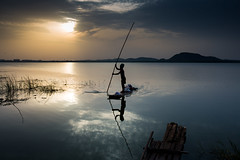 The sailor (Karthikeyan.chinna) Tags: karthikeyan chinnathamby chinna travel waterscapes water reflection wide 1635mm lake kolavai chennai chengelpat sunrise sun india tamilnadu south sunlight boat fisherman fishiing fishing