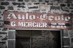 Auto-cole (haijee13) Tags: old school france st stone wall french driving pierre 15 peinture boutique flour mur mercier auvergne vieux vieille devanture cantal stflour