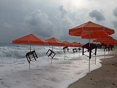 Storm in grey and orange (Wider World) Tags: sea orange cloud storm beach umbrella greece kefalonia kephalonia cephalonia ionian