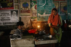 The BHAPA PITHA couple (N A Y E E M) Tags: vendors couple winter night food stall tea lamp kerosene street navalavenue chittagong bangladesh candid carwindow bhapapitha