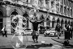 The Master of the Bubbles (Petricor Photography) Tags: street blackandwhite white black milan art photography candid milano and canonpersonalconnection