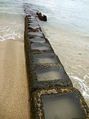 beach barrier (kenjet) Tags: ocean beach hawaii pier sand waves waikiki oahu cement wave pacificocean pools barrier waikikibeach divider