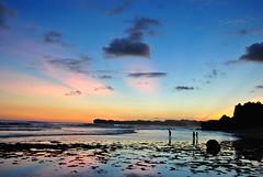 Sunset at Indrayanti (Cursed Boy) Tags: blue sunset shadow sea sky people orange cloud black beach nature indonesia landscape photography sand nikon rocks no jogja editing yogyakarta pantai nikond3000 indrayanti pantaiindrayanti