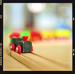 Toy train (Bregg) Tags: toy train colors dof film kodakportra160 mamiyac330 80mmf28 tracks