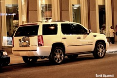 white Escalade (David Ripamonti) Tags: road street new york city people usa white black cars car rock night america canon landscape eos lights big traffic zoom top taxi cadillac lincoln rockefeller 50 rims across escalade 50d