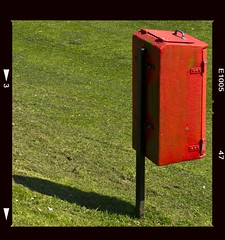red box/green grass (friendlydrag0n) Tags: red 2 two color colour green film grass contrast trash square vibrant bin litter rubbish faux boz
