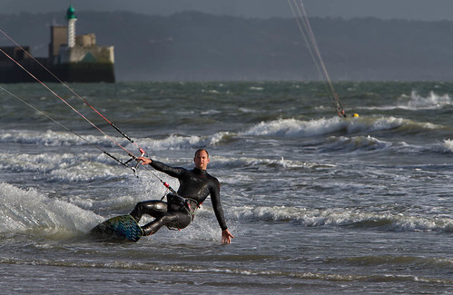 Kite surfer skimming the water
