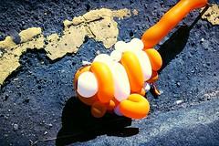 191/365 an imaginary line (werewegian) Tags: street orange white texture abandoned rose toy balloon creature kerb yellowline day191 jul13 day191365 werewegian 3652013 week28theme htcone 365the2013edition 10jul13