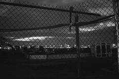 Fencing (Denn-Ice) Tags: street nyc newyorkcity blackandwhite bw ny newyork blancoynegro monochrome night fence blackwhite noir fuji bokeh manhattan fujinon blackandwhitephotography blackwhitephoto xpro1 fujixpro1 fuji18mmf2