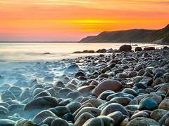 IMG_7084 - EXPLORE #7 (andreassofus) Tags: ocean longexposure travel sunset summer sky sun beach nature water beautiful stone canon landscape happy skne amazing cool rocks exposure waves sweden south wave happiness stunning clound ystad travelphotography kseberga