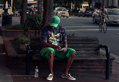 Life's Choices (FarCorner) Tags: life street people man brick green water look hat bench photography 50mm nc nikon downtown sitting looking candid northcarolina ticket down sneakers lottery cap short sit casual choice nikkor scratch curb chapelhill decision photog d300 vision:text=0541 vision:car=0685 vision:outdoor=0888