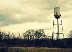 Sleighton Water Tower (LindsayErin) Tags: trees abandoned field clouds crossprocess watertower desolate