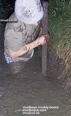 loggers (MudboyUK) Tags: man guy mud boots dirty lad logger muddy catarpillar loggers vision:outdoor=0986