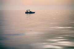 Morning Catch (kranjay) Tags: sky sunlight reflection water silhouette reflections fishing fisherman waves wave sicily ripples fishingboat
