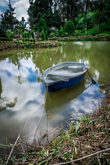 Parked (Ng Shu Yuan) Tags: park longexposure sky motion reflection green nature water landscape boat amazing nikon earth malaysia pong sabah mothernature masterpiece waterpark waterscape tawau sabahan nikonfx lazyshutter nikond750