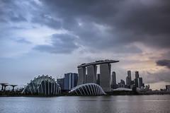 The heart of the city (Chin Li Zhi) Tags: sea skyline architecture marina buildings singapore downtown cityscape skyscrapers heart ominous towers dramatic human fujifilm drama x100 x100s