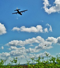 Hercules (2) (howell.davies) Tags: camera uk sky wales clouds plane river airplane countryside fly flying aircraft transport flight olympus fields hercules raf compact c130 hedges hendy loughor