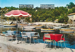 Incredibly Boring Postcards (40) (Goran Patlejch) Tags: sea beach jadran adriatic yugoslavia 1960s 60s sixties postcard rijeka hotellucija water tables parasols umbrella chairs restaurant boats boring nobody harbor sun summer vacation happiness empty patlejch patlejh goenetix gntx trees red tablecloth concrete