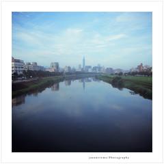 Taipei Blues (jasoncremephotography) Tags: reflection tlr film rollei analog rolleiflex river fuji slide velvia fujifilm taipei taipei101 台灣 台北 fujichrome e6 fw 台北101 基隆河 filmphotography rvp100 filmisnotdead istillshootfilm rolleiflexfw