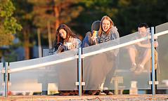 Taking in the Sunset (Poocher7) Tags: friends sunset people ontario canada smile youth laughing fence bench fun evening sitting dusk lap chilling blanket boardwalk talking joyful lakehuron hangingout prettygirls goldenhour 3girls grandbend coffees hff watchingthesunset sittingonlap glassfence 1guy