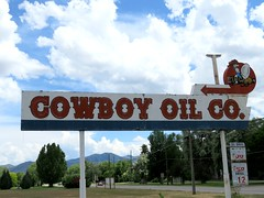 Cowboy Oil Co. (1 of 3) (jimsawthat) Tags: sky urban clouds neon gasstation idaho vacant outofbusiness servicestation pocatello metalsigns vintagesigns
