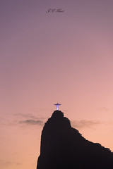 Sunset in the Redeemer (Jos Eduardo Nucci) Tags: world city travel pink winter sunset sky sun sunlight mountain art classic beach nature silhouette yellow statue riodejaneiro wonderful landscape nikon flickr colours peace br purple outdoor faith landmark icon christtheredeemer scenary getty layers 28300mm magichour blessed palette d800 laranjeiras cosmevelho botafogobeach corcovadohill joseduardonucci