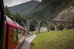 Brusio Viaduct (Anton Andreev) Tags: bridge red mountain alps nature stone train switzerland carriage scenic engineering railway viaduct express bernina brusio