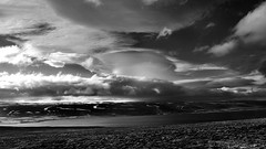 a naturally tumultuous love affair (lunaryuna) Tags: bw monochrome clouds landscape coast blackwhite iceland shoreline fjord lunaryuna cloudscape westfjords lenticularclouds panoramicviews sjky weathermood northwesticeland lightmood enroutetoholmavik anticipationofastorm