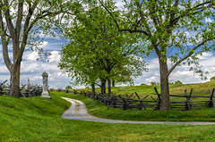 The Bloody Lane, Antietam (loco's photos) Tags: road blue trees sky green monument clouds fence nationalpark pentax maryland dirt national antietam battlefield splitrail sharpsburg fa31 k30 sunkenlane fa31limited bloodylanetrail