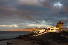 Carmen's dawn (grapfapan) Tags: morning sea beach clouds sunrise palms dawn seaside spain lanzarote canarias puertodelcarmen
