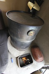 The rocket mass heater uses inexpensive materials including 3,000 - 5,000 lbs of cob, the clay and sand material that serves as thermal mass to store heat. (Green Energy Futures) Tags: wood calgary fire burning flame stove alberta permaculture efficiency woodburning biomass rocketstove rocketmassheater greenenergyfutures