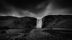The Calling (vulture labs) Tags: travel light 2 sky blackandwhite bw white mountain man black art nature water monochrome clouds dark landscape person photography mono photo waterfall iceland lowlight rocks 2000 moody fineart hill fine wide dramatic wideangle monotone monochromatic falls southern photograph labs pro lone vulture 169 lightroom waterscape skogafoss skogarfoss dodgeandburn d700 fineartphotograph 1424mm silverefex vulturelabs