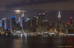MIdtown Manhattan - Lunar eclipse (Photosequence) Tags: street new city nyc newyorkcity bridge usa moon newyork reflection skyline brooklyn canon river reflex downtown cityscape unitedstates manhattan nj midtown uptown timessquare empire brooklynbridge eastriver jersey newyorkskyline empirestate astronomy hudson gotham northeast bigapple lunar eastcoast 42nd northjersey theatredistrict photosequence supermoon faizanphotography