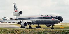 Delta MD-11 N814DE-old old colours, Manchester, 13-4-02e (Proplinerman) Tags: 2002 manchester aircraft delta douglas airliner md11 mcdonnell jetliner mcdonnelldouglas trijet deltaairlines n814de