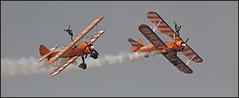 Breitling Wingwalkers (kimbenson45) Tags: orange white airplane flying stripes aircraft flight aeroplane formation striped wingwalking acrobatic propellors biplanes boeingstearman breitlingwingwalkers wingswheelsdunsfold2013