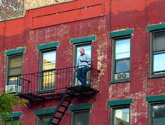(Goggla) Tags: new york nyc window fire escape village cigarette cellphone east smoker