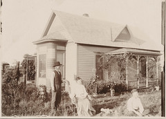 Couple and black servant sit in the yard (simpleinsomnia) Tags: ranch old white house black home monochrome vintage blackwhite couple antique farm posed photograph servant