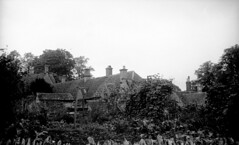 England 1938, Bibury Arlington Row 20-016 (rich701) Tags: england blackandwhite bw london castle church windmill thames 35mm vintage garden 1930s bradford compton 1938 rustic cottage negative stonehenge windsor winchester corfe bradfordonavon wisley avebury burton cirencester thatched silburyhill castlecombe lacock bibury elstead thursley shere witley thatchroof filmroll blewbury greywell tilford hagbourne uptongrey corfevillage wanborough hendred aldsworth arebury arelingtonrow staintcross