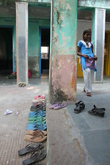 Shoes lined up outside a classroom in Pali, Rajasthan