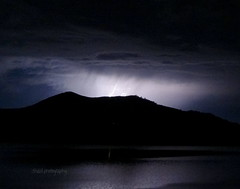 Lightning on the Water (Shaid Photography) Tags: california light shadow sky white mountain lake storm black mountains detail reflection art nature water beautiful beauty up rain weather night clouds wow skyscape landscape photography mirror crazy amazing cool interesting perfect pretty glow force power view darkness awesome science views heat bolt stunning electricity bolts thunderstorm strength nightsky lightning incredible lightningbolt breathtaking perfection naturalart sierranevadas lightrays jawdropping lightningstorm