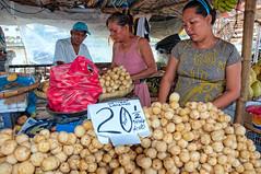 Lanzones Vendor (benchorizo) Tags: fruits nikon asia candid philippines streetphotography capiz banias roxascity d90 lanzones wowphilippines benchorizo romeobanias