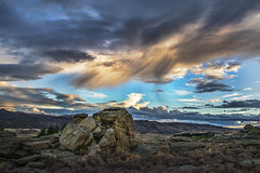 """""""There are no rules of architecture for a castle in the clouds."""" (Ian@NZFlickr) Tags: sunset rain rock clouds near central boulder alexandra maybe nz otago tor coming"""