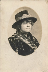 Portrait of an African American woman (simpleinsomnia) Tags: old woman white black monochrome hat vintage found blackwhite serious antique african kentucky snapshot photograph american africanamerican vernacular oval foundphotograph