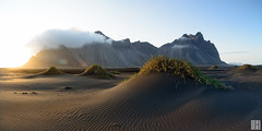 Vesturhorn, view from Stokksnes (gregor H) Tags: light sunset sea panorama sun sunlight mountain seascape texture beach nature landscape island dawn blacksand coast is iceland windy beam serene southeast graphite lowangle austurland vestrahorn grasshills stokksnes