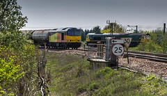 Colas Class 60 no 60047 meets an unidentified Freightliner Class 66 at Newark Flat Crossing on 05-05-2016 with the Rectory to Lindsey discharged tanks (kevaruka) Tags: blue red england orange cloud sun colour sunshine yellow clouds composition train canon outdoors photography spring flickr colours afternoon outdoor stock may rail railway sunny trains 5d locomotive newark frontpage britishrail nottinghamshire sunnyday 2016 networkrail 60047 canonef1635f28mk2 canon5dmk3 5dmk3 canonef100400f4556l 5d3 5diii canoneos5dmk3 newarkdiamondcrossing newarkflatcrossing ilobsterit 05052016
