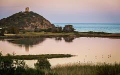 Chia Laguna Sunset (MaxSkyMax) Tags: sardegna trees sunset italy reflection tower grass night canon reflections italia sardinia flamingo horizon hill fair lagoon springtime fenicotteri