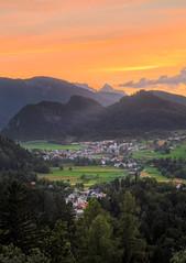 Sunset from Bled Castle (Dejan Hudoletnjak) Tags: sunset orange mountains nature landscape warm village orangesky sunsetting
