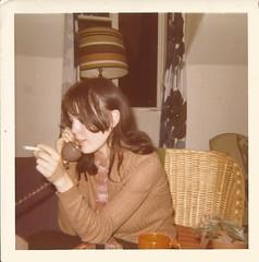 Julie is on the phone again, 1971 (STUDIOZ7) Tags: woman girl teen teenager smoking smoker cigarette 1970s seventies 70s telephone phone avacadogreen suburbia