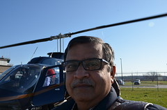 The receptionist kindly offered to take my picture against the chopper (oldandsolo) Tags: road lake toronto ontario canada airport chopper highway aircraft flight tourists helicopter suburbs charming lakeontario landed camwhoring niagaraonthelake customers heliport selfie freshwaterlake disembarkation helicopterride heritagetown historicaltown scenicflight rotarywingaircraft bell206lhelicopter belllongrangerii loveliesttownincanada nationalhelicoptersincniagaraonthelake